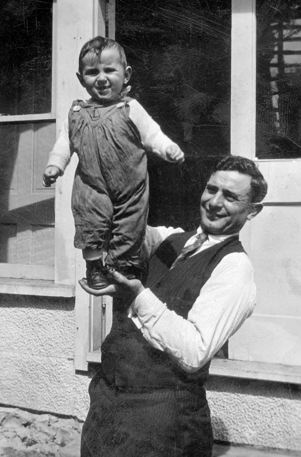 man and baby boy possibly Lyle Nelson